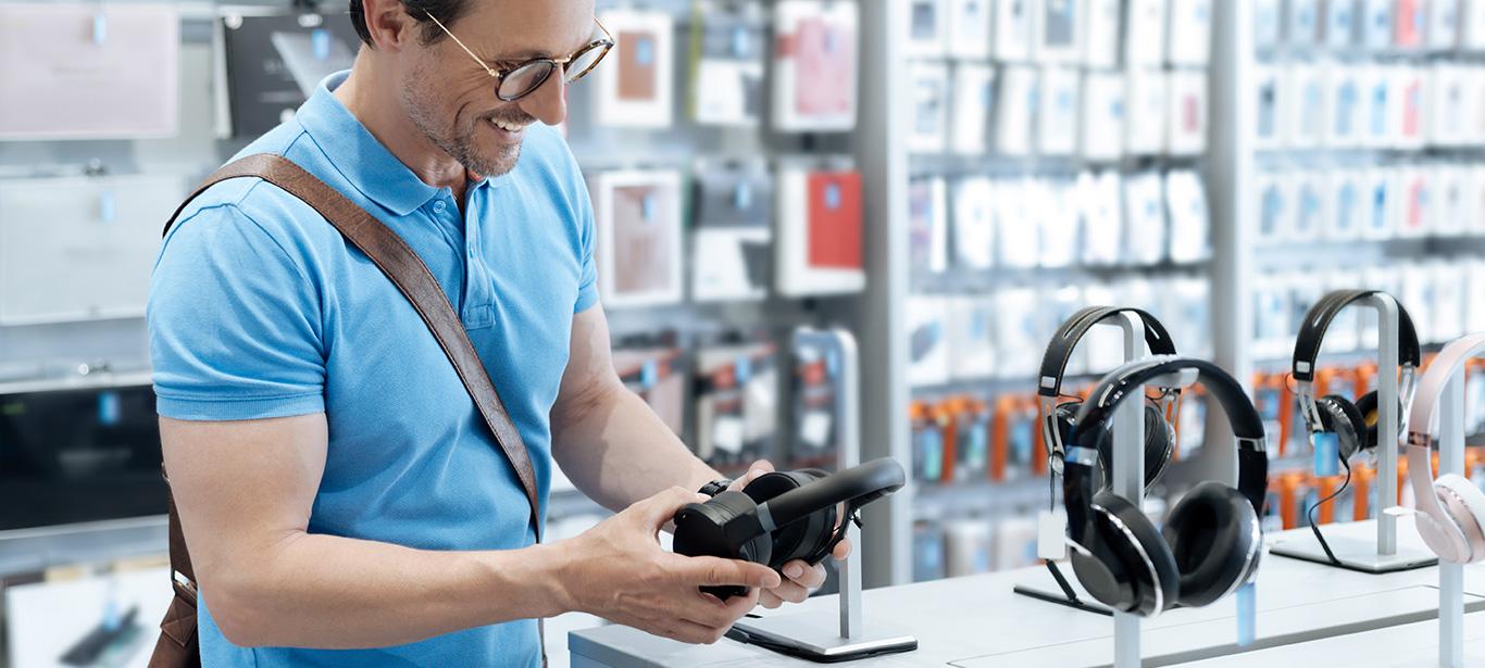 Man looking at headphones